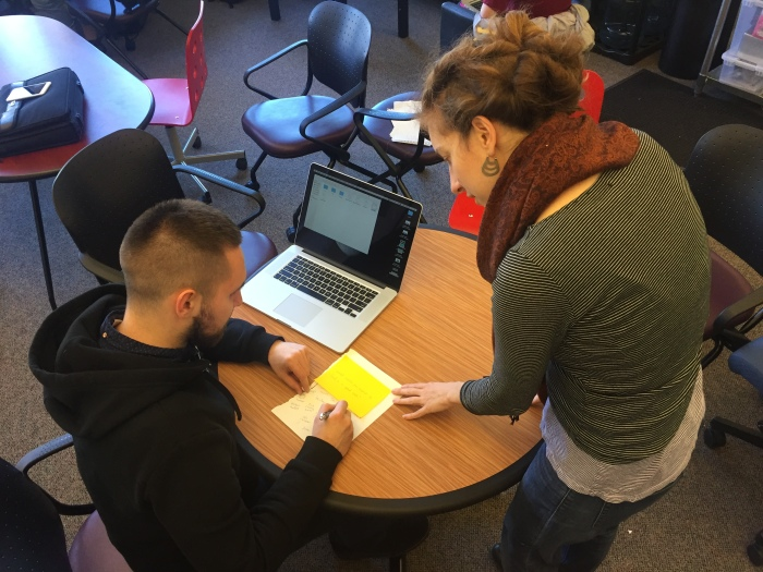 Researcher conducting concept testing to prioritize public engagement ideas.