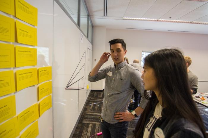 Facilitator guiding a workshop participant during the scenario selection step.