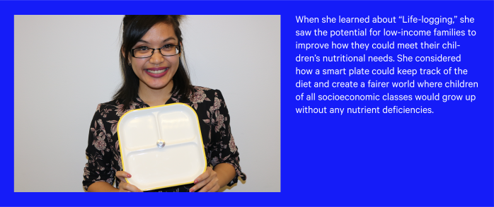 A participant holding her prototype of an idea based on tracking nutritional needs of children.