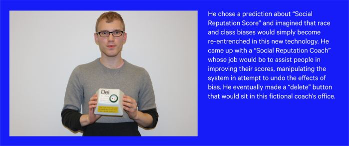 """A participant holding his prototype of an idea based on """"social reputation coach"""" to undo the effects of race and class biases."""